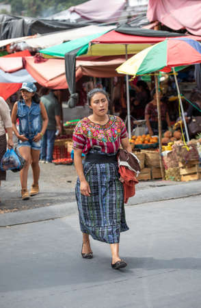 chichicastenango, Guatemala, 27th February 2020: mayan woman walking at the traditional market Editöryel