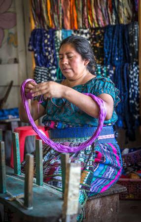 Lake Atitaln, Guatemala, 26th february 2020: mayan woman preparing yarns to weave traditional fabrics