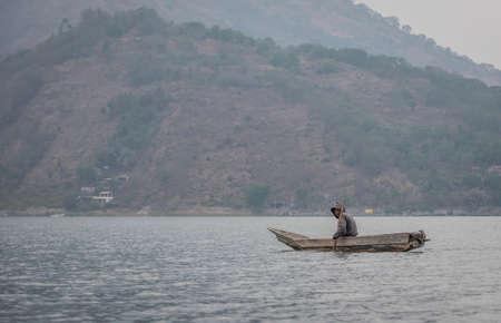 Lake Atitlan, Guatemala, 25th February 2020: fisherman on the lake Atitlan in his traditional boat