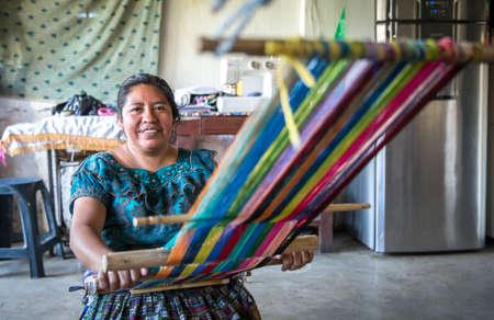 Lake Atitaln, Guatemala, 26th february 2020: mayan woman weaving colorful, traditional fabrics