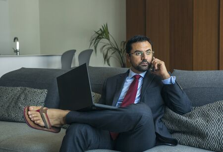 arab man in a suit working at home in his city apartment