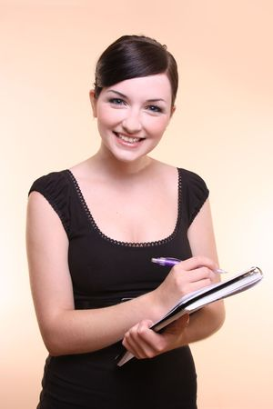 Young woman holding notepad and pen Stock Photo - 4940304