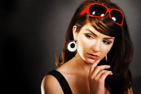 Attractive  Funky 60s retro woman on dark backround