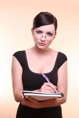 Woman holdling notebook and pen note taking Stock Photo - 4940302