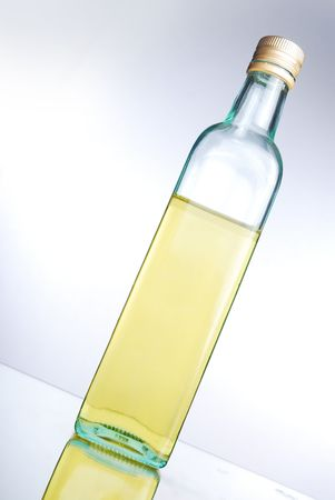 A bottle of cooking oil/olive oil on a reflective surface Stock Photo - 5030175