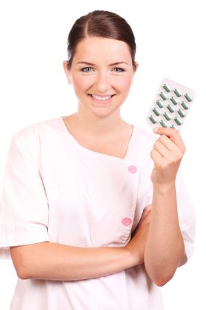 A beautiful young nurse holding a blister pack of tablets/pills and smiling to the camera. Stock Photo - 5085050