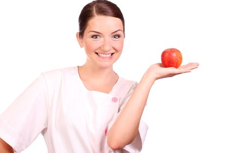 A nursedietican holding up an apple and smiling. photo