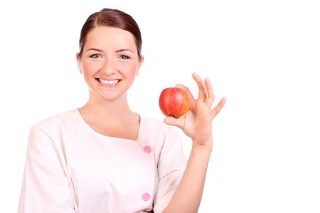 A pretty young nursedietician holding up an apple and smiling. photo