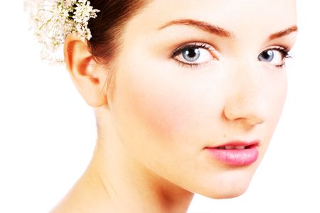 A close up of a beautiful woman looking into the camera in front of a white background. photo
