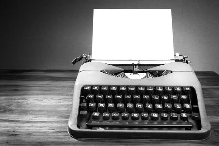Old typewriter on table in black and white Foto de archivo