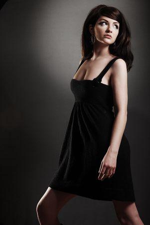 Attractive / Funky 60's retro woman on dark backround Stock Photo - 5156363