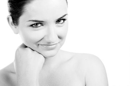 A beautiful young woman looking at the camera and smiling on a white background.Black and white. photo