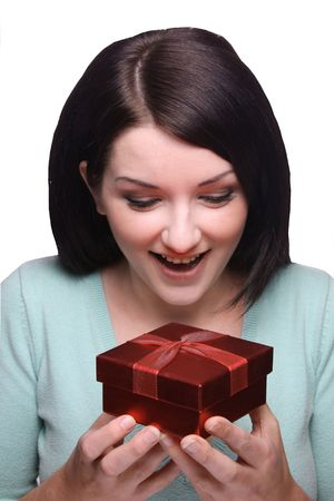 joyfully: Brunette girl looking down joyfully at a received gift