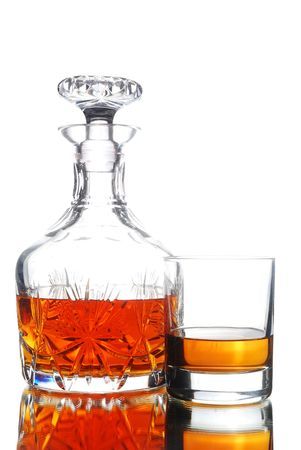 decanter: Decanter and glass full of WhiskeyScotch on White Stock Photo