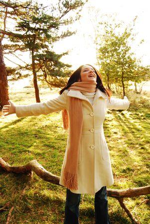 Happy brunette woman in autumn scene Stock Photo - 5437904