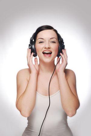 Smiling girl wearing headphones photo