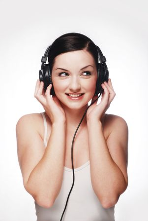 Smiling girl wearing headphones and looking to the side photo