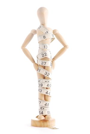 artists mannequin: Artists mannequin with measuring tape Stock Photo