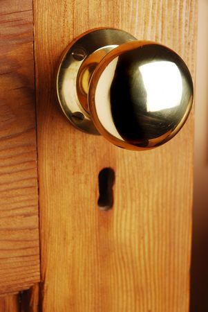 Old fashioned brass doorknob and keyhole Stock Photo - 5469912