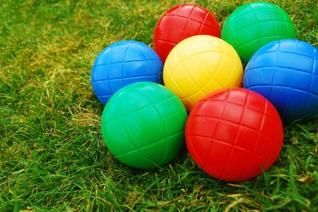 Vibrant Multi-coloured balls on grass
