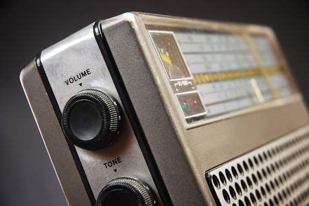 Close up detail of old radio, tone and volume knobs photo