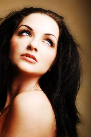 beauty shot: A beautiful young brunette woman looking up to the side. Beauty shot.