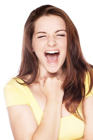 ecstatic: A beautiful young woman fist pumping and screaming as if she has had some good news.