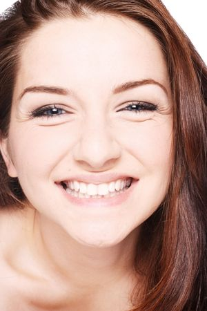 A close up of a beautiful young smiling brunette woman. photo