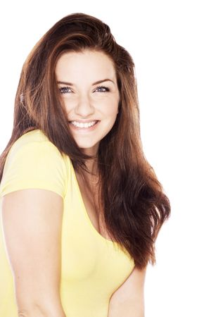 A beautiful young woman smiling in front of a white background. photo