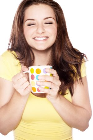 A beautiful young woman smiling and holding her mug. Stock Photo - 5596744