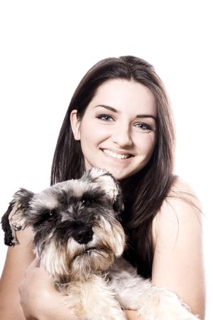 A pretty girl holding her Miniature Schnauzer and smiling on a white background. Copy space above. photo