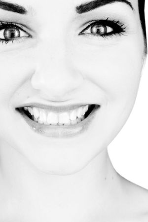 A black and white close up of a beautiful smiling young woman in front of a white background. Studio/Beauty shot. Stock Photo - 5787084