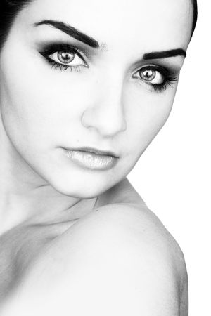 A black and white close up of a beautiful young woman in front of a white background. Studio/Beauty shot. Stock Photo - 5787086