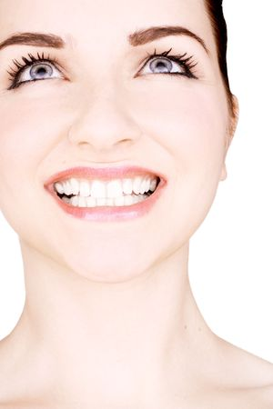 A close up of a smiling beautiful young woman in front of a white background. StudioBeauty shot. photo