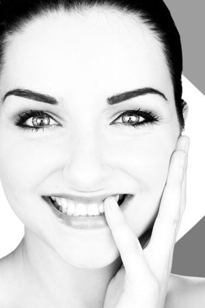 A black and white close up of a beautiful smiling young woman in front of a white background. StudioBeauty shot. photo