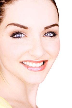 A close up of a beautiful smiling young woman in front of a white background. StudioBeauty shot. photo
