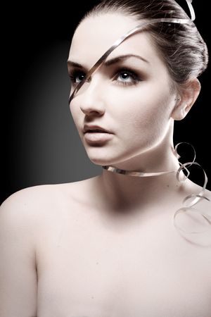 A beauty shot of an attractive young woman wearing ribbon around her head and face. Stock Photo - 6121232