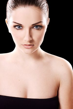 A close up of a beautiful young woman in front of a black background. photo