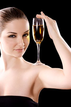 Beautiful woman with champagne glass on a black background. photo