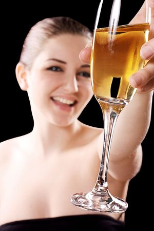 Beautiful smiling woman with champagne glass on a black background. Stock Photo - 6172142