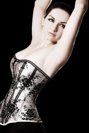 A beautiful young woman posing in a pretty corset. Stock Photo