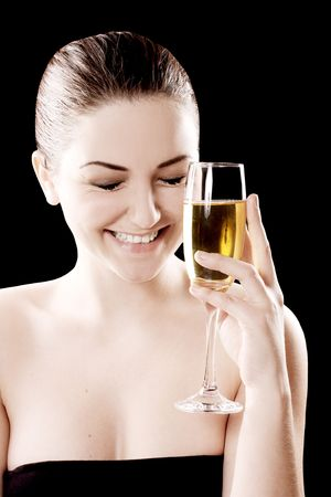 Beautiful smilinglaughing woman with champagne glass on a black background. photo