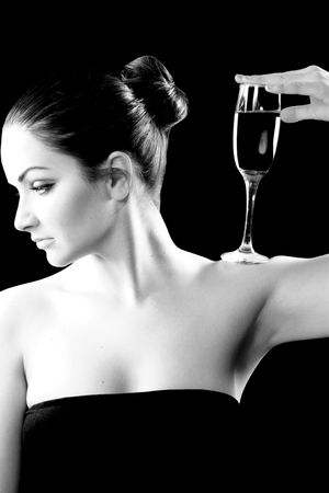 A black and white image of a beautiful woman with a champagne glass on her shoulder. Stock Photo - 6190301