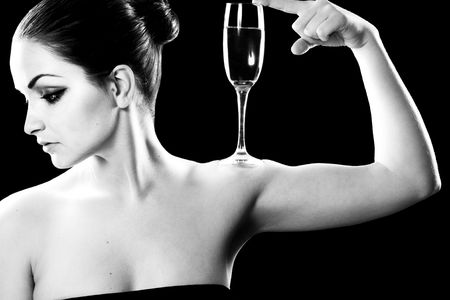Beautiful woman with champagne glass on a black background. Stock Photo - 6227309