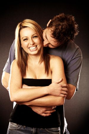 An attractive Couple cuddling and smiling photo