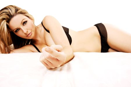 come on: A beautiful young woman lying on her bed and telling you to come to her.