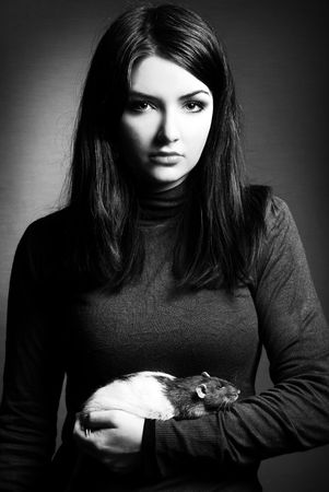 A black and white image of a woman and her pet rat. Stock Photo - 6835430