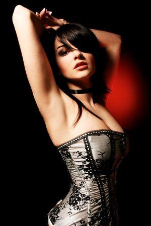 A close up of eine schöne junge Frau, die ein Korsett zu tragen.