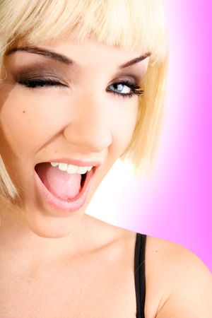 Funky young woman wearing a wig and winking in front of a pink background.