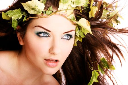 A beautiful young woman with ivy in her hair. photo